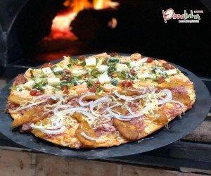 20% de desconto sobre o valor da pizza grande, não incluso taxa de entrega. Não cumulativo com outras promoções.
